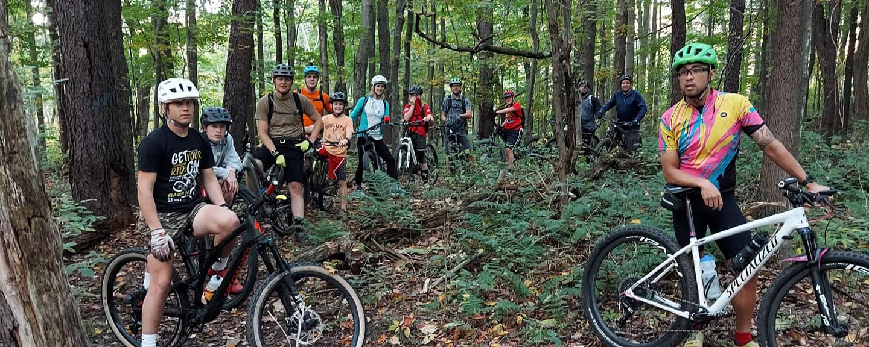 mountain bikers take a break along the trail